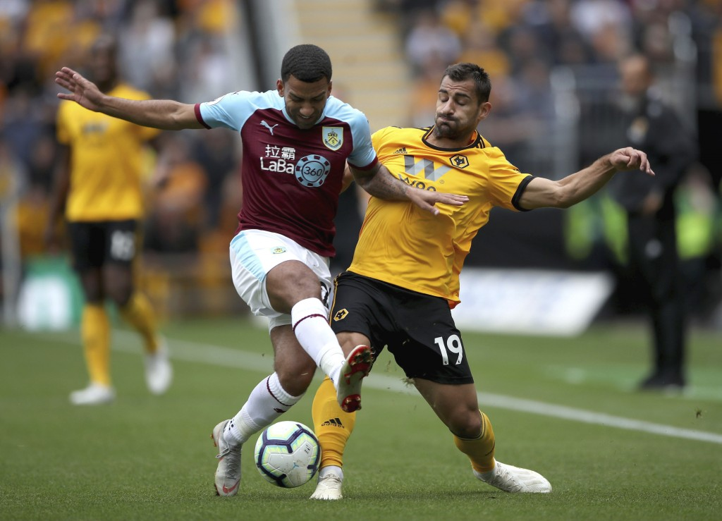 Burnley's Aaron Lennon, left vies for the ball with Wolverhampton Wanderers' Jonny Castro during the English Premier League soccer match between Wolve