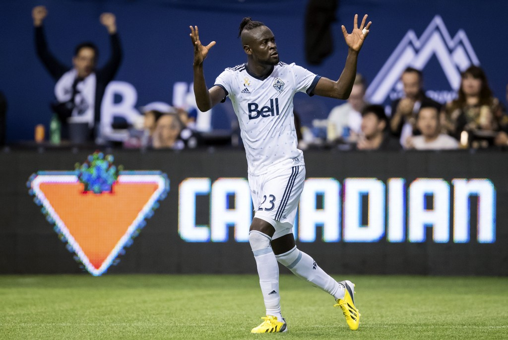 Vancouver Whitecaps' Kei Kamara celebrates his goal against the Seattle Sounders during the first half of an MLS soccer match, Saturday, Sept. 15, 201