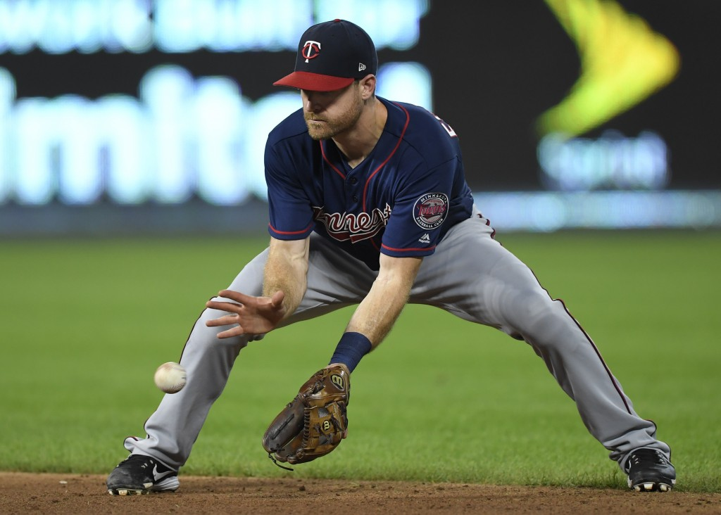 Minnesota Twins second baseman Logan Forsythe makes a play on a ground ball to throw out Kansas City Royal Rosell Herrera at first base during the fif