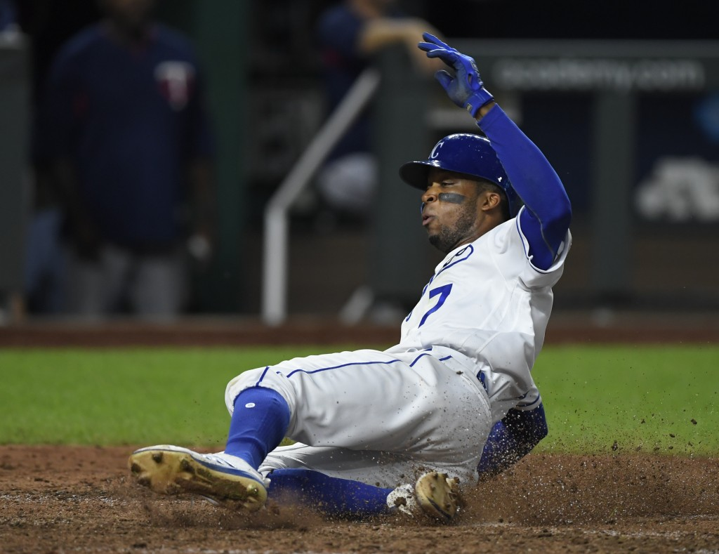 Kansas City Royals' Rosell Herrera slides safely into home to score against the Minnesota Twins during the seventh inning of a baseball game in Kansas