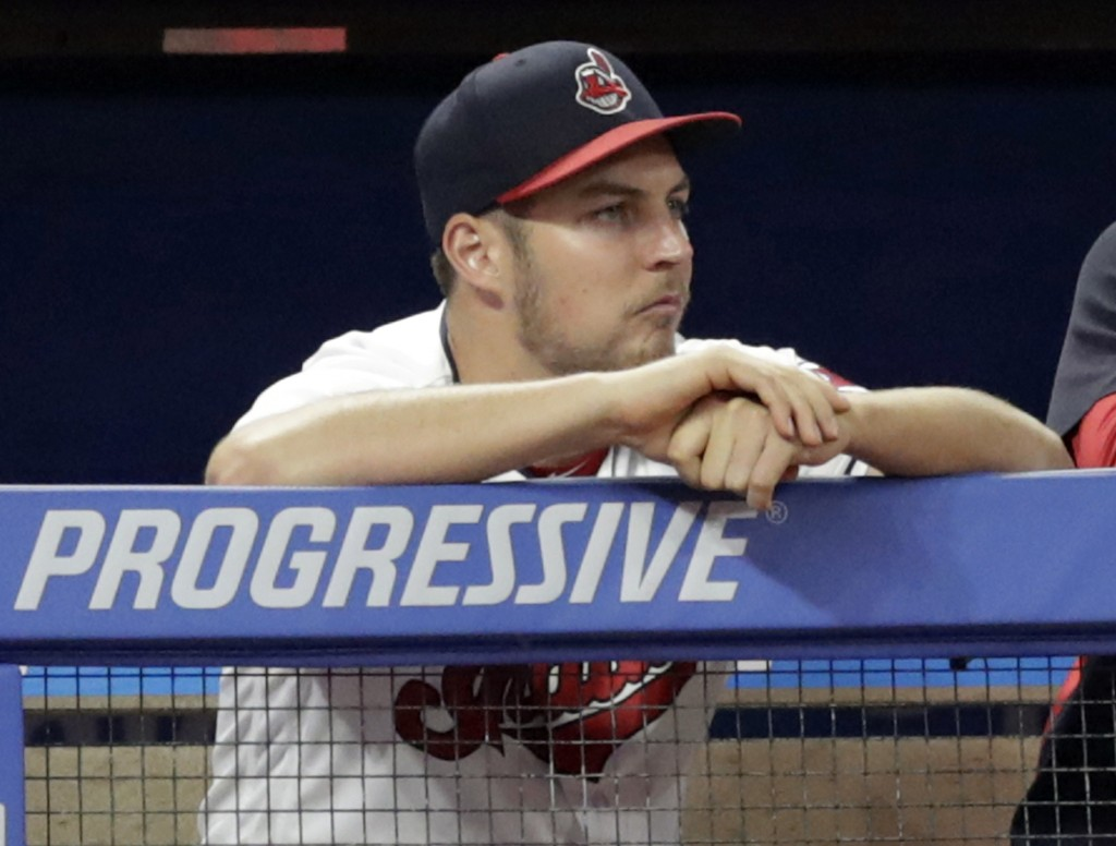 FILE - In this July 10, 2018, file photo, Cleveland Indians pitcher Trevor Bauer watches from the dugout during the ninth inning of a baseball game ag