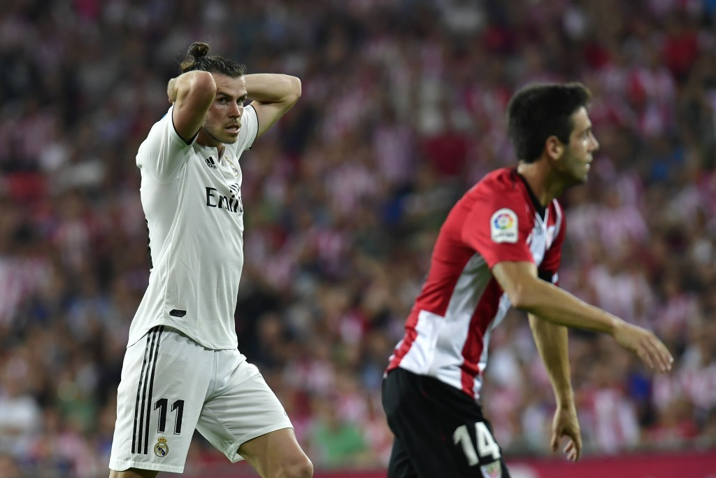 Real Madrid 's Gareth Bale reacts after missing a goal against Athletic Bilbao during the Spanish La Liga soccer match between Athletic Bilbao and Rea
