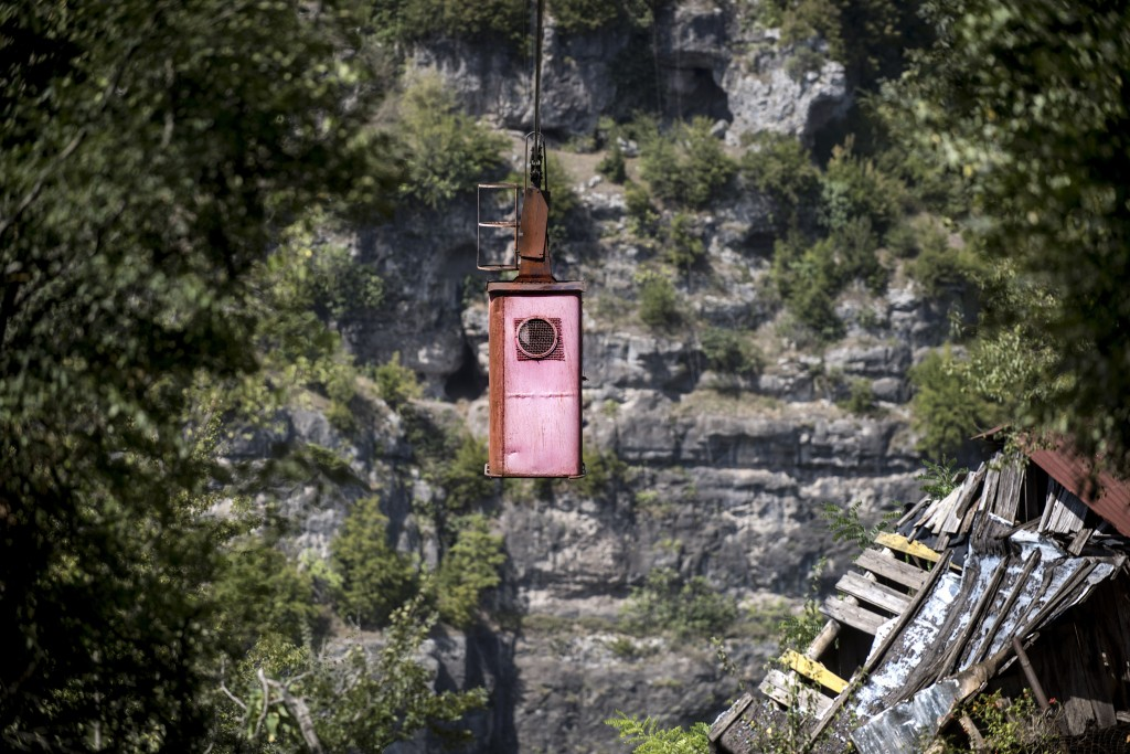In this photo taken on Thursday, Aug. 30, 2018, a cable car travels, in the Georgian city of Chiatura, about 200 kilometers ( 125 miles) from Tbilisi,