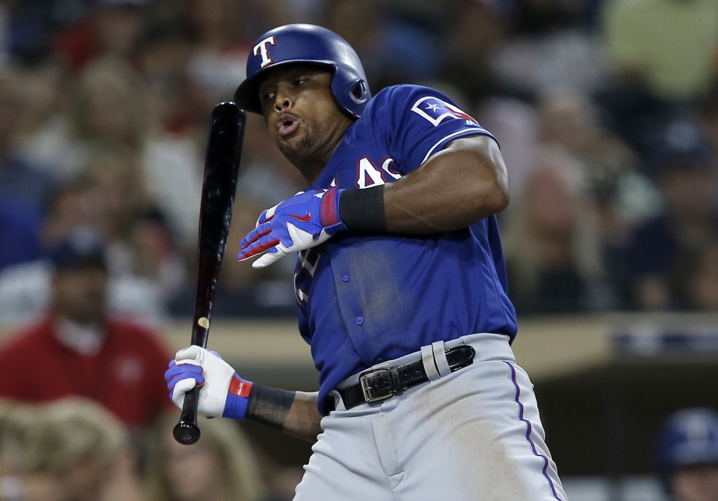 Texas Rangers' Adrian Beltre gets out of the way of a San Diego Padres pitched ball to draw a walk during the sixth inning of a baseball game in San D