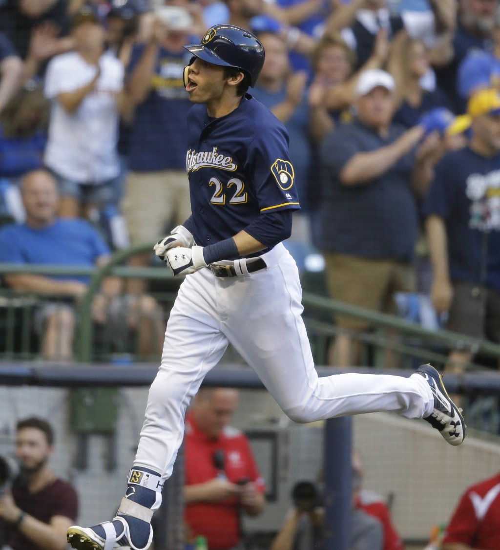 Milwaukee Brewers' Christian Yelich reacts after his home run off Pittsburgh Pirates starting pitcher Ivan Nova during the first inning of a baseball