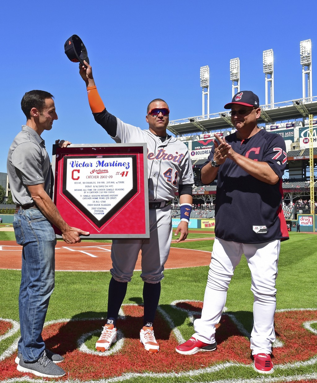 Detroit Tigers' Victor Martinez, center, waves to fans acknowledging his retirement during a pregame ceremony before a baseball game between the Cleve