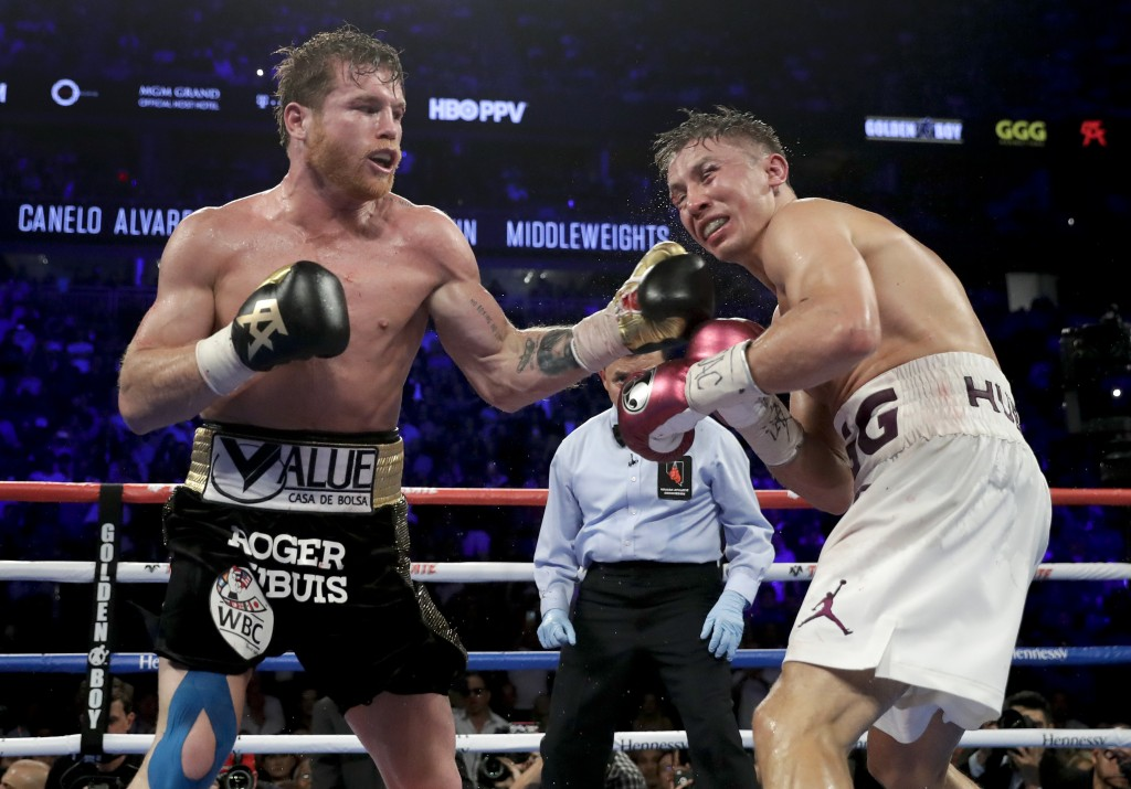 Canelo Alvarez lands a punch against Gennady Golovkin in the 12th round during a middleweight title boxing match, Saturday, Sept. 15, 2018, in Las Veg...