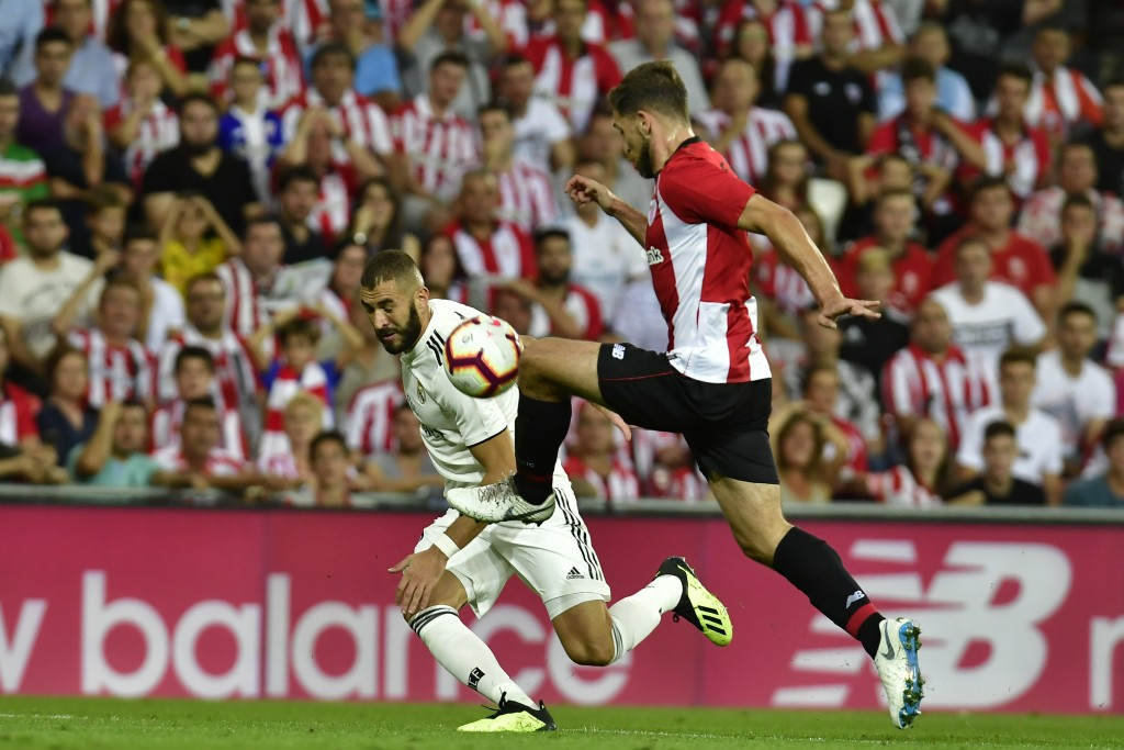 Athletic Bilbao's Yeray Alvarez duels for the ball with Real Madrid's Kari during the Spanish La Liga soccer match between Athletic Bilbao and Real Ma