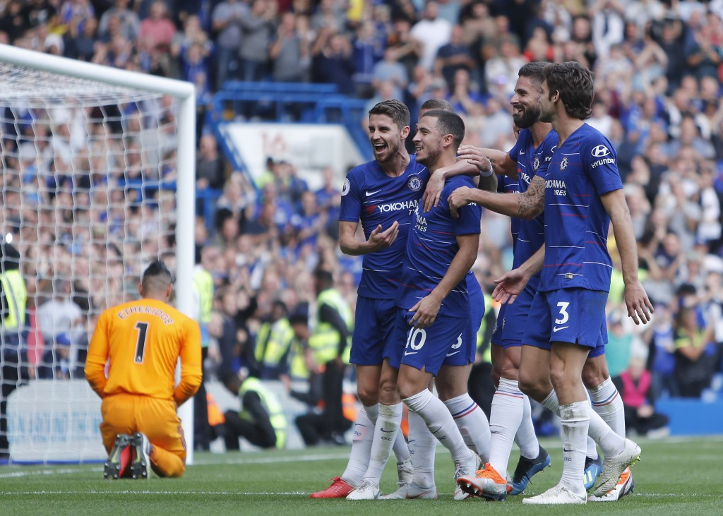 Chelsea's Eden Hazard, second left celebrates after scoring from the penalty spot for his third goal of the game during their English Premier League s