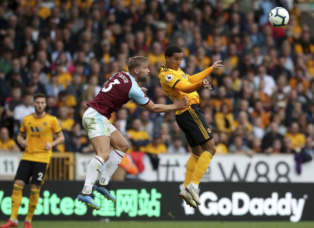 Burnley's Charlie Taylor, left, and Wolverhampton Wanderers' Helder Costa jump for an aerial ball during their English Premier League soccer match at