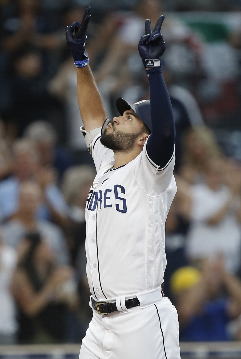 San Diego Padres' Eric Hosmer reacts as he returns to the plate after hitting a three-run home run against the Texas Rangers during the third inning o