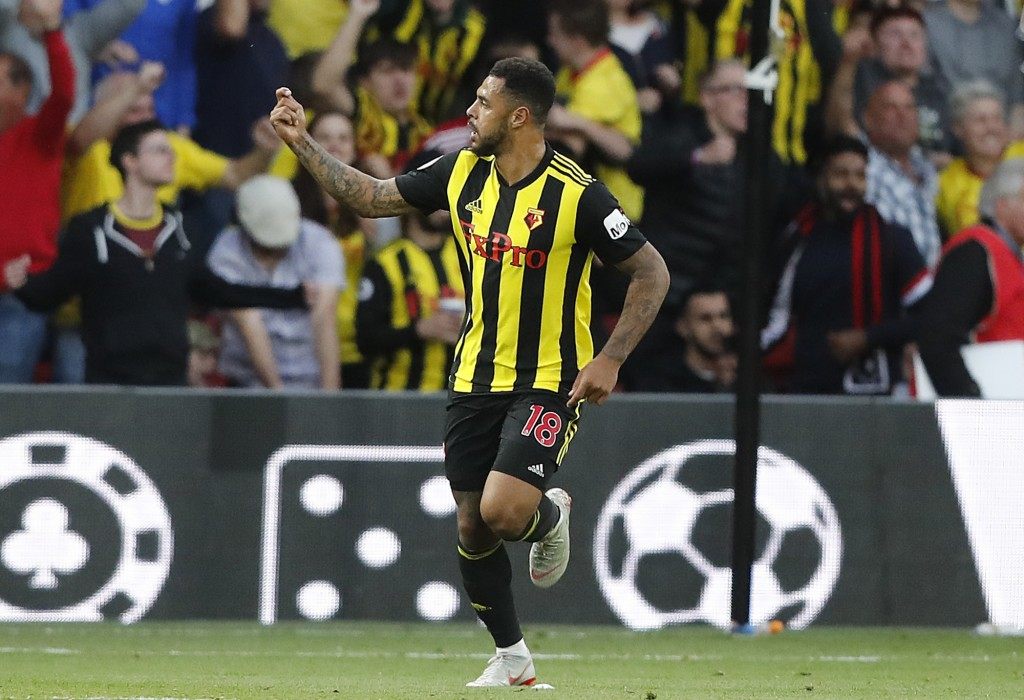 Watford's Andre Gray celebrates after scoring his side's first goal during the English Premier League soccer match between Watford and Manchester Unit