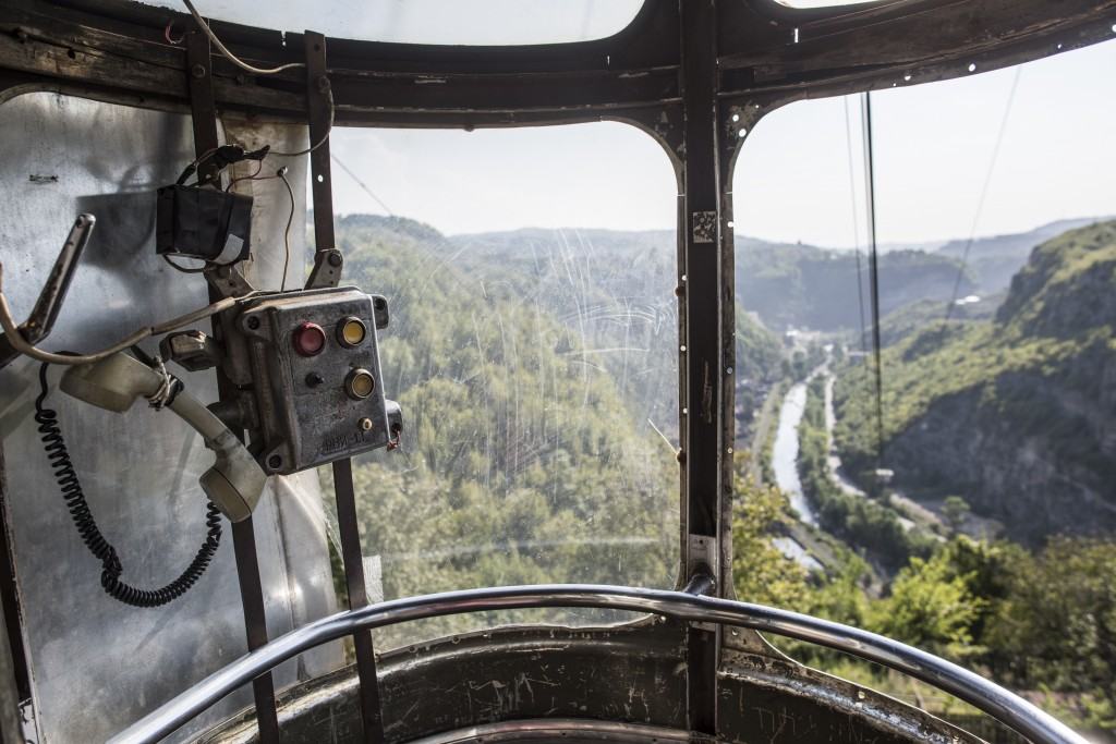 In this photo taken on Wednesday, Aug. 29, 2018, a view of the gorge from a cable car with a soviet era emergency telephone set and buttons in the Geo...