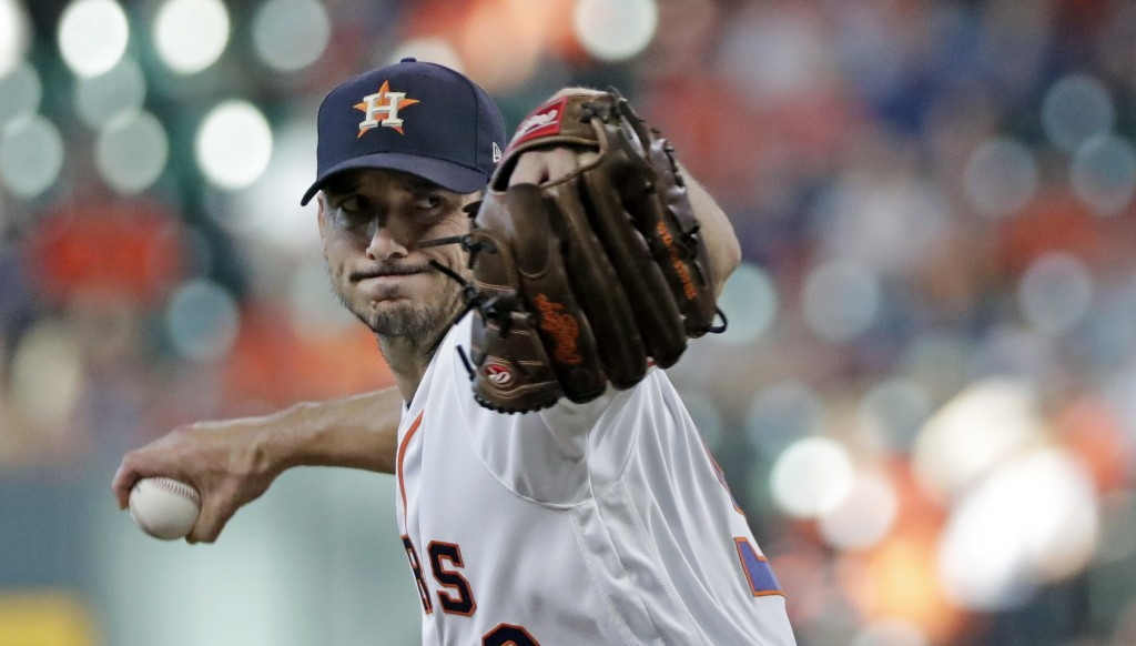 Houston Astros starting pitcher Charlie Morton throws against the Arizona Diamondbacks during the first inning of a baseball game Saturday, Sept. 15,