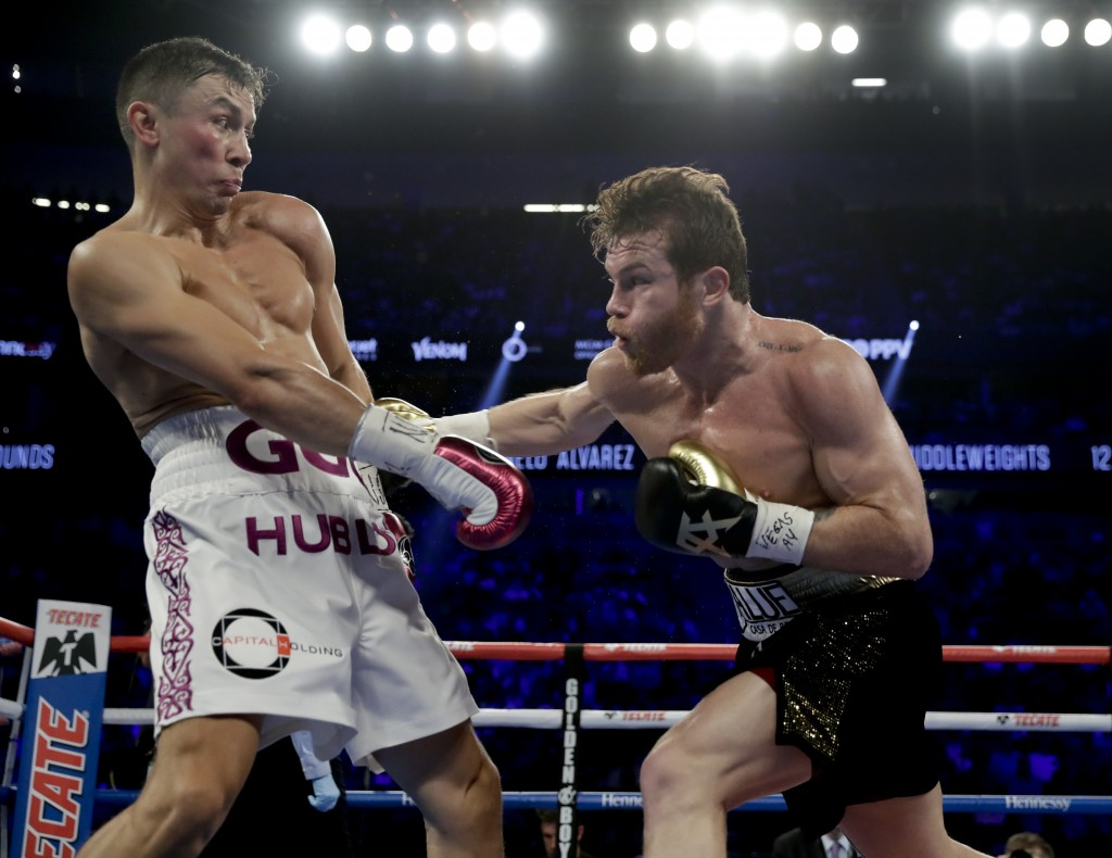 Gennady Golovkin, left, and Canelo Alvarez trade punches in the second round during a middleweight title boxing match, Saturday, Sept. 15, 2018, in La...