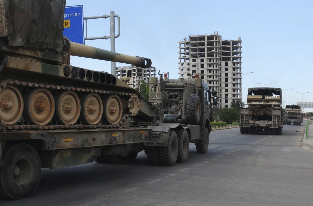 FILE - This Friday, Sept. 14, 2018 file photo, a convoy of Turkish military trucks carrying tanks destined for Syria, moves near the town of Kilis, Tu...