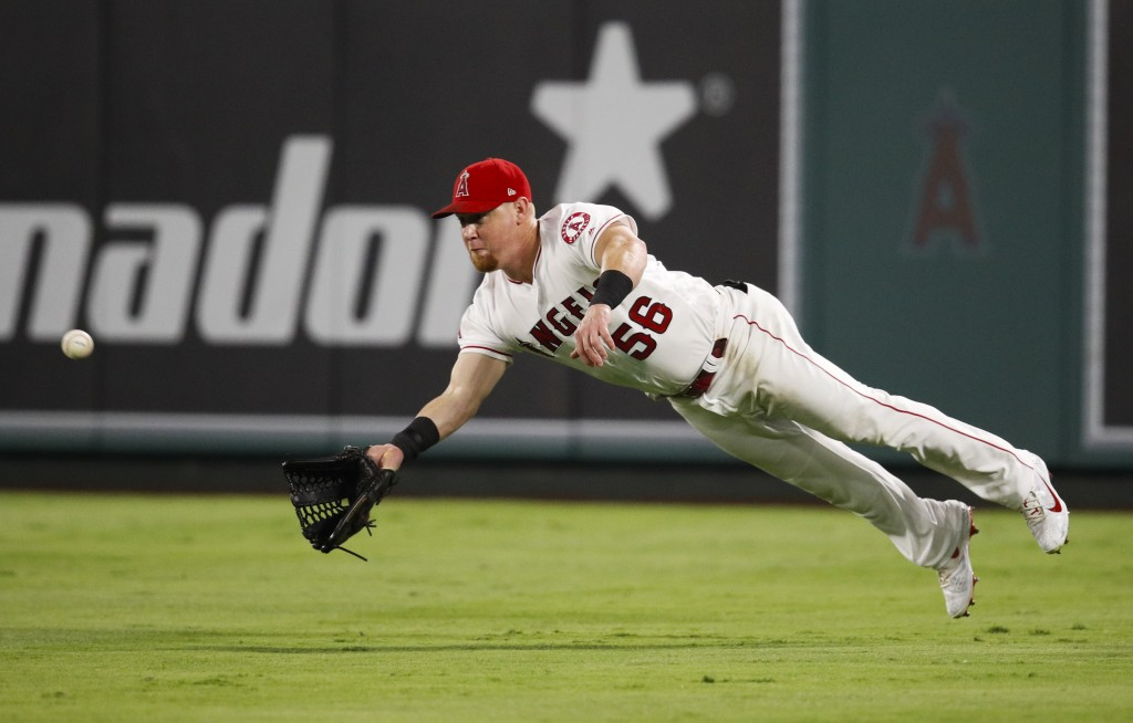 Los Angeles Angels' Kole Calhoun dives to catch a ball hit by Seattle Mariners' Dee Gordon during the eighth inning of a baseball game, Saturday, Sept