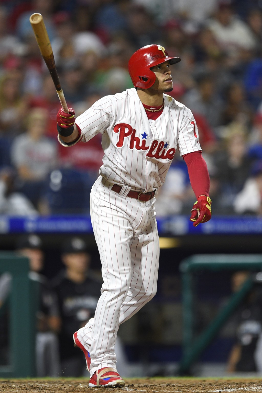 Philadelphia Phillies' Cesar Hernandez watches his three-run home run off Miami Marlins' Drew Rucinski during the fifth inning of a baseball game, Sat