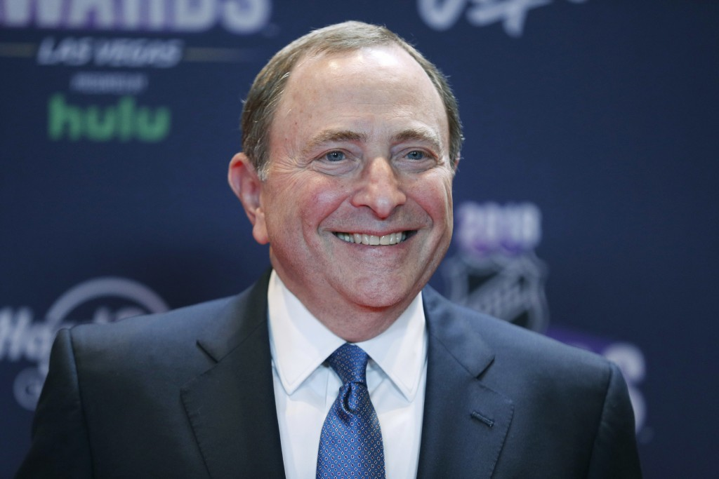 FILE - In this June 20, 2018, file photo, Gary Bettman, commissioner of the National Hockey League, poses on the red carpet before the NHL Awards in L