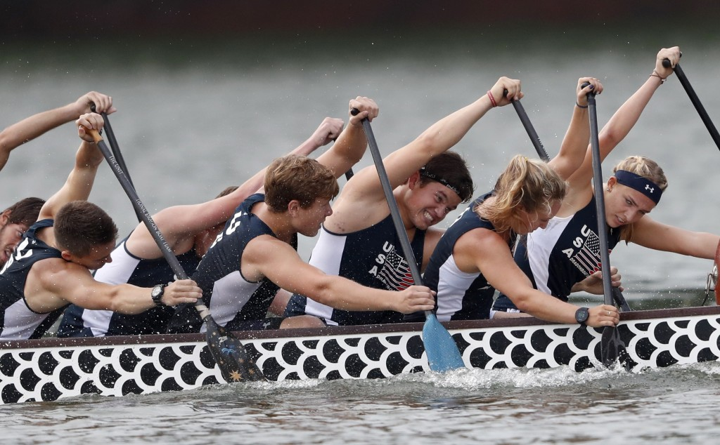In this Thursday, Sept. 13, 2018 photo, a dragon boat crew from the USA paddles for the finish line during a 500-meter heat at the ICF Dragon Boat Cha
