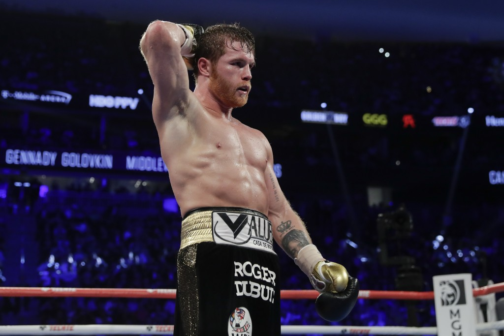 Canelo Alvarez reacts after a middleweight title boxing match against Gennady Golovkin, Saturday, Sept. 15, 2018, in Las Vegas. (AP Photo/Isaac Brekke...