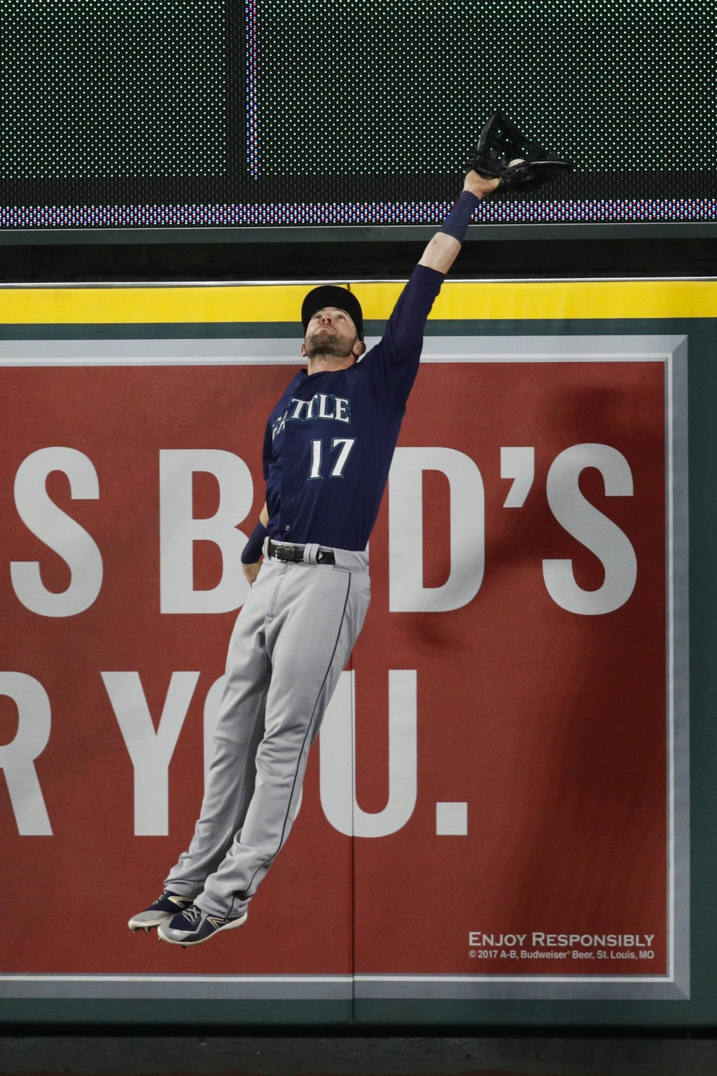 Seattle Mariners' Mitch Haniger leaps to catch the ball hit by Los Angeles Angels' Justin Upton during the sixth inning of a baseball game, Saturday,