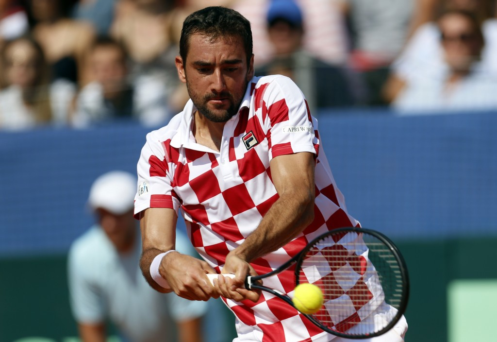Marin Cilic of Croatia returns a shot to Sam Querrey of the United State during their Davis Cup semifinal singles match in Zadar, Croatia, Sunday, Sep