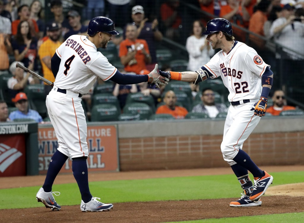 Houston Astros' Josh Reddick (22) celebrates with George Springer (4) after hitting a home run against the Arizona Diamondbacks during the second inni