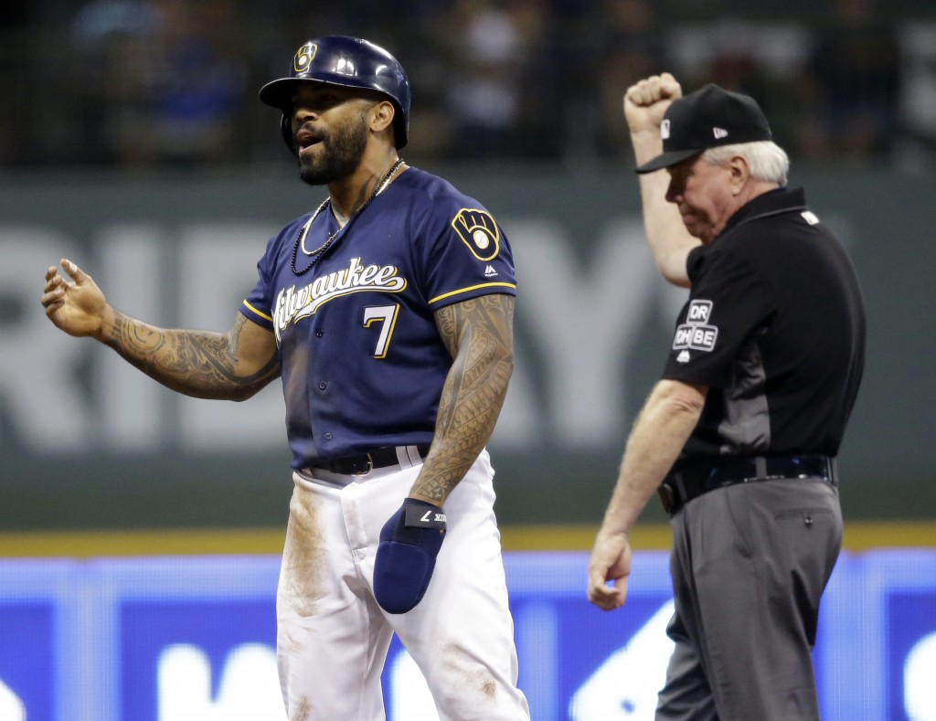 Milwaukee Brewers' Eric Thames (7) reacts after umpire Brian Gorman calls him out for running out of the baseline during a rundown against the Pittsbu