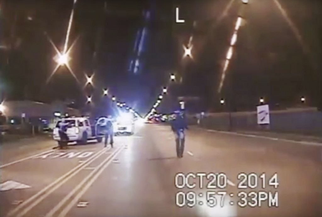 FILE - In this Oct. 20, 2014 file image taken from dash-cam video provided by the Chicago Police Department, Laquan McDonald, right, walks down the st