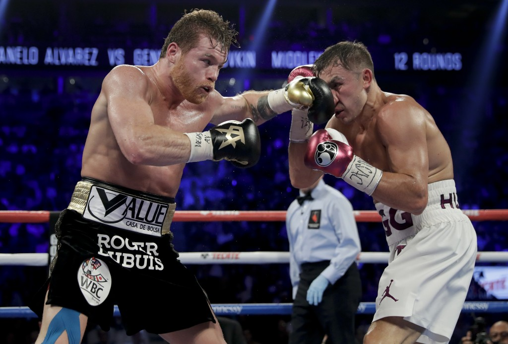 Canelo Alvarez, left, and Gennady Golovkin trade punches in the sixth round during a middleweight title boxing match, Saturday, Sept. 15, 2018, in Las