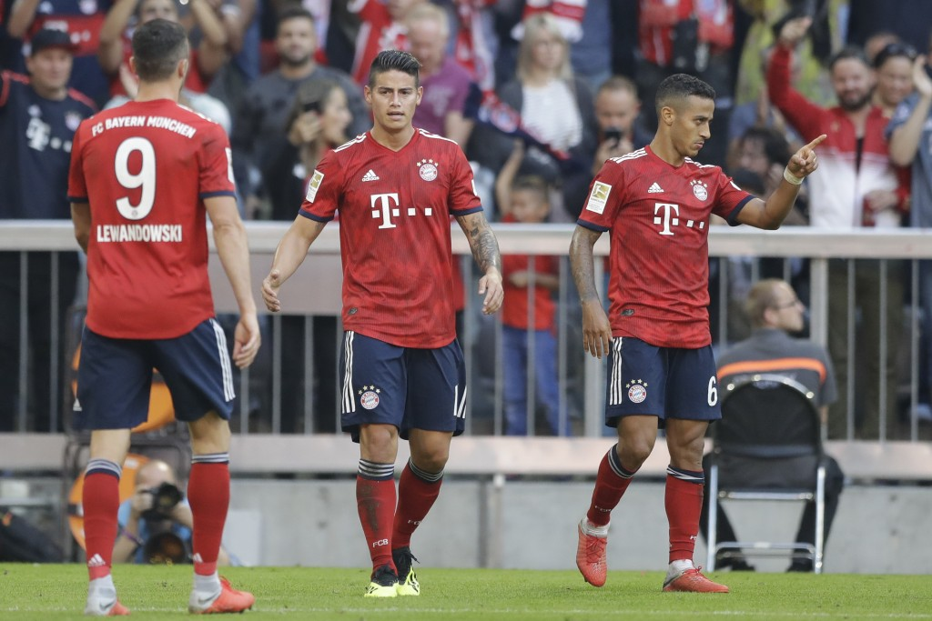 Bayern's scorer James, center, and his teammates celebrate their side's third goal during the German Bundesliga soccer match between FC Bayern Munich