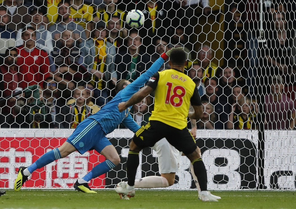 Watford's Andre Gray, right, scores his side's first goal during the English Premier League soccer match between Watford and Manchester United at Vica