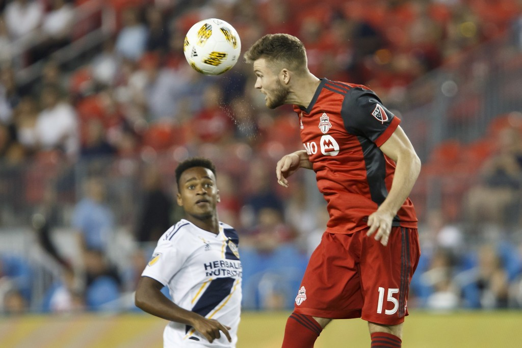 Toronto FC forward Eriq Zavaleta (15) hits a header during the first half of an MLS soccer game against the LA Galaxy, Saturday, Sept. 15, 2018 in Tor