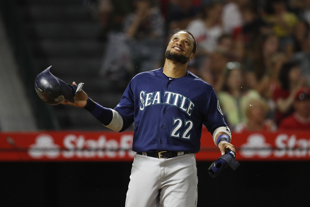 Seattle Mariners' Robinson Cano smiles after the top of the eighth inning of a baseball game against the Los Angeles Angels, Saturday, Sept. 15, 2018,