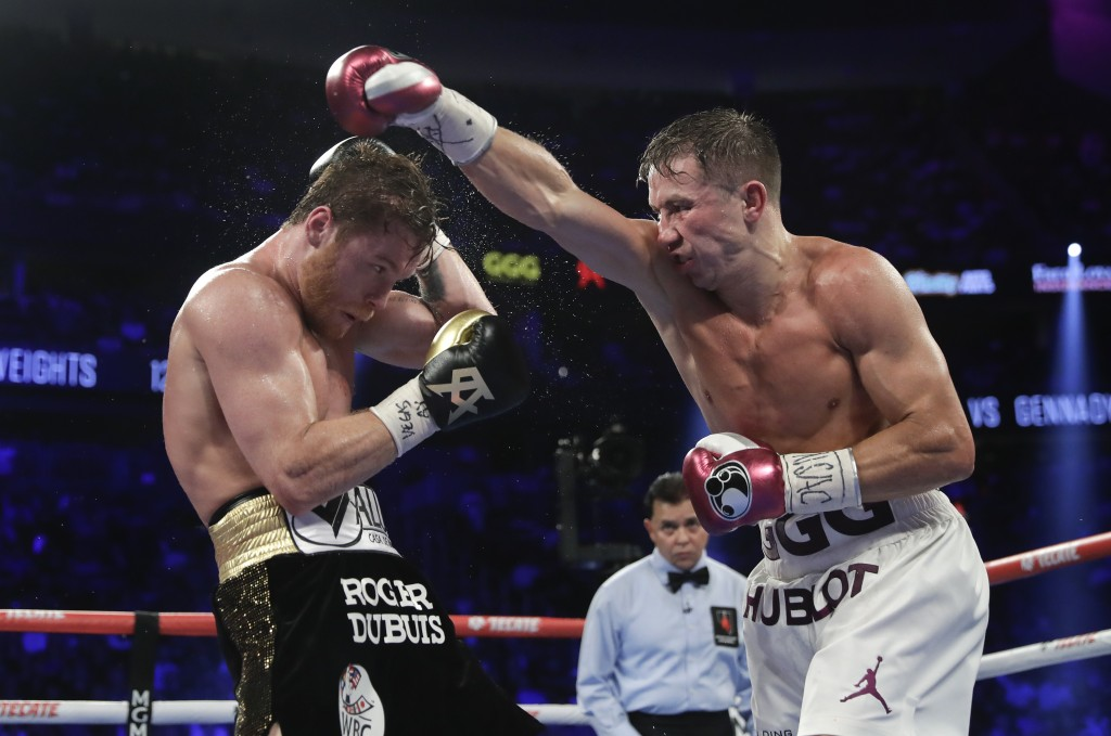 Canelo Alvarez, left, and Gennady Golovkin trade punches in the seventh round during a middleweight title boxing match, Saturday, Sept. 15, 2018, in L...