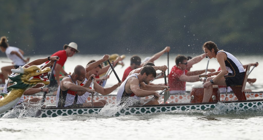 In this Thursday, Sept. 13, 2018 photo, a dragon boat crew from Germany paddles for the finish line during a 500-meter heat at the ICF Dragon Boat Cha