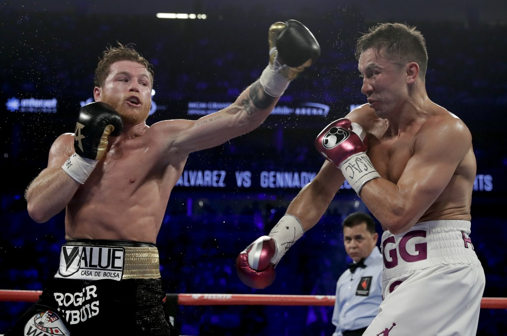 Canelo Alvarez, left, and Gennady Golovkin trade punches in the third round during a middleweight title boxing match, Saturday, Sept. 15, 2018, in Las