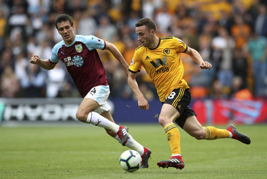 Burnley's Jack Cork, left, in action with Wolverhampton Wanderers' Joao Moutinho during their English Premier League soccer match at Molineux stadium