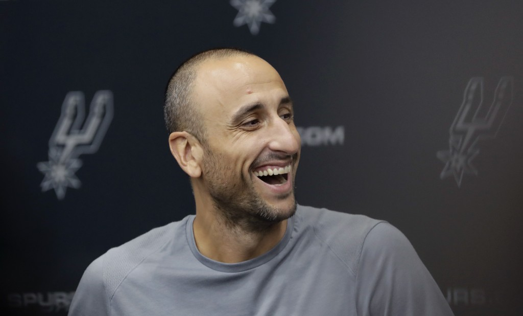 Former San Antonio Spurs guard Manu Ginobili jokes with the media at the NBA basketball team's practice facility, Saturday, Sept. 15, 2018, in San Ant