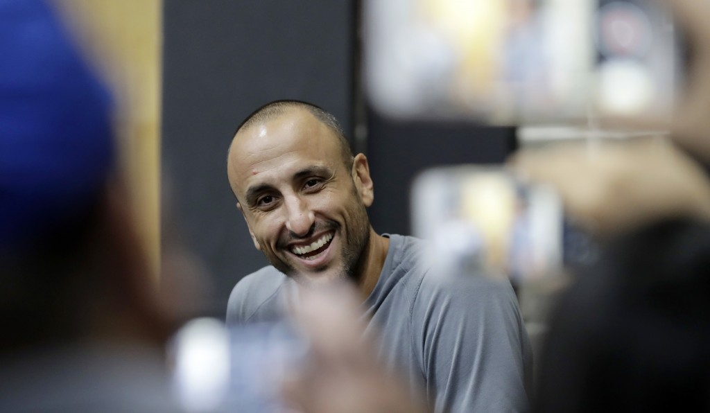 Former San Antonio Spurs guard Manu Ginobili talks to the media at the NBA basketball team's practice facility, Saturday, Sept. 15, 2018, in San Anton