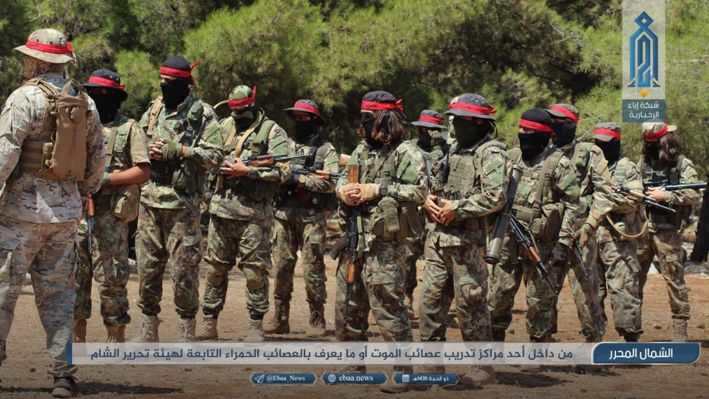 This photo provided Monday, Aug 20, 2018, by the al-Qaida-affiliated Ibaa News Network, shows fighters of the al-Qaida-linked coalition known as Hay'a