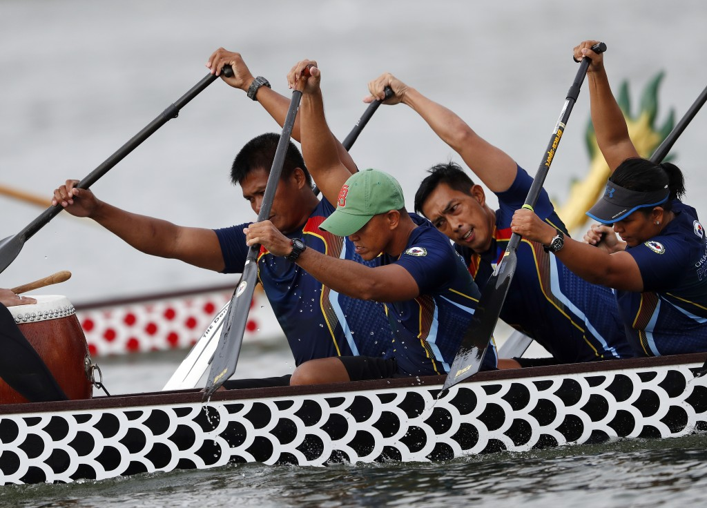 In this Thursday, Sept. 13, 2018 photo, a dragon boat crew from the Philippines paddles for the finish line during a 500-meter heat at the ICF Dragon