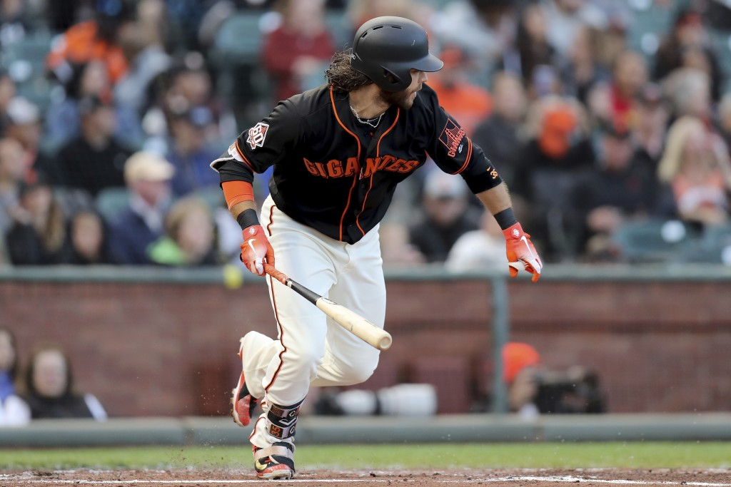 San Francisco Giants shortstop Brandon Crawford (35) singles in the second inning of a baseball game against the Colorado Rockies in San Francisco, Sa