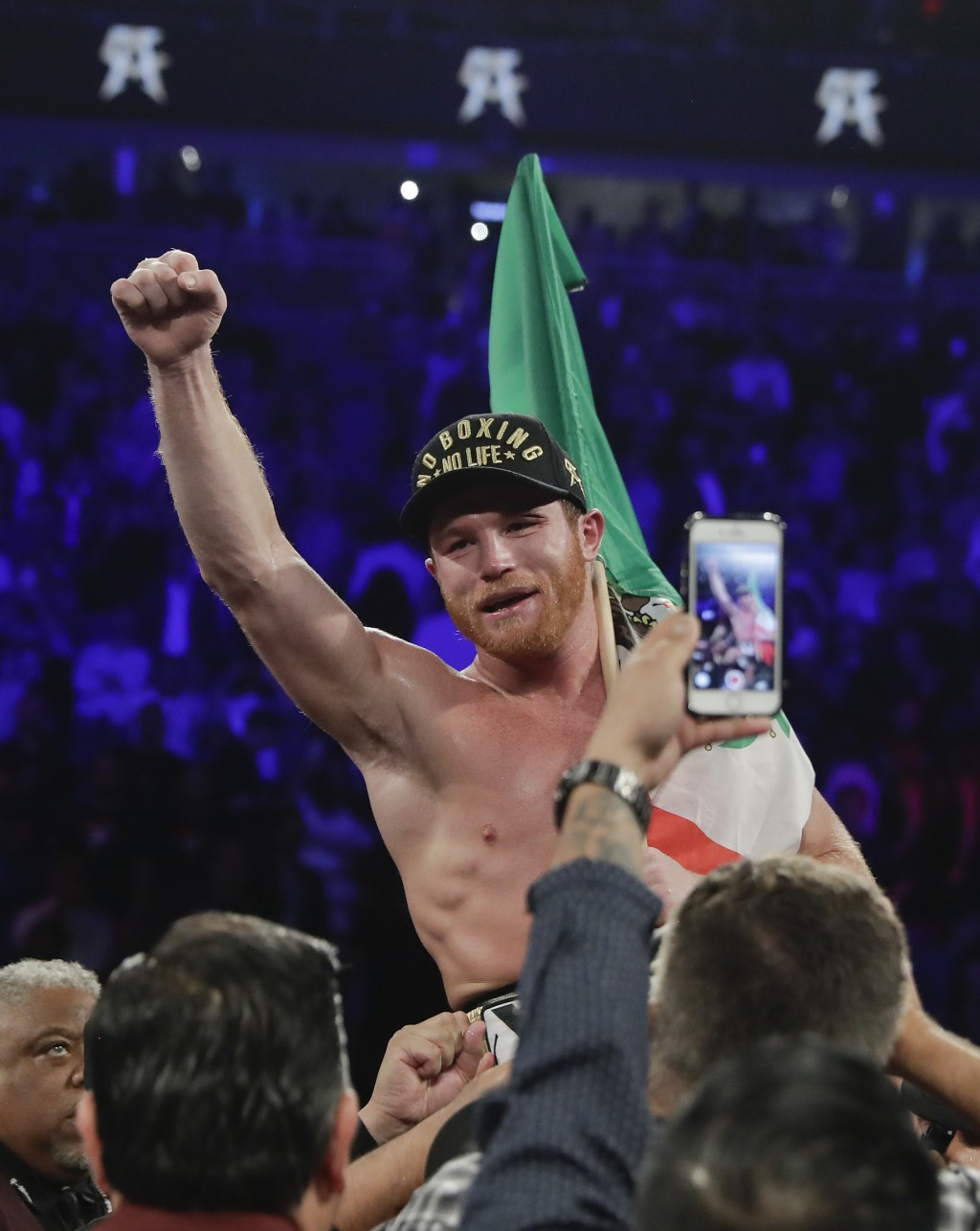 Canelo Alvarez celebrates after defeating Gennady Golovkin by majority decision in a middleweight title boxing match, Saturday, Sept. 15, 2018, in Las...