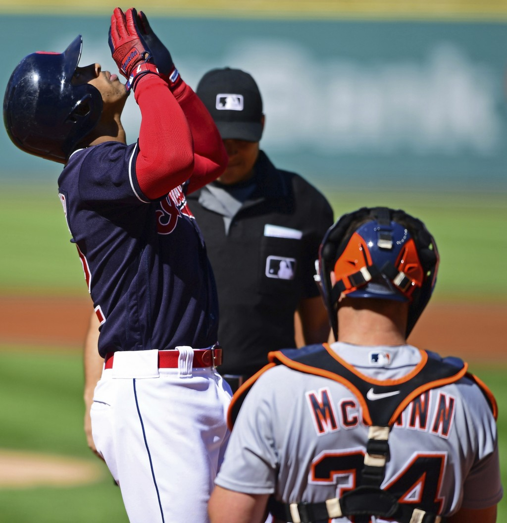Cleveland Indians' Francisco Lindor celebrates after hitting a solo home run in the first inning of a baseball game against the Detroit Tigers, Saturd