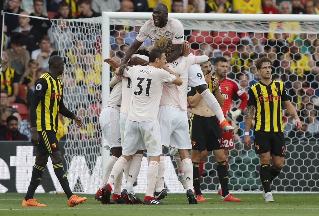 Manchester United teammates celebrate after scoring their side's second goal during the English Premier League soccer match between Watford and Manche