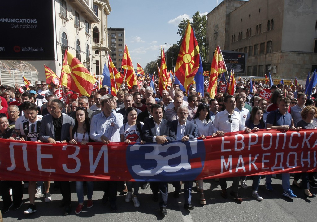 "Macedonian Prime Minister Zoran Zaev, center, takes a part in a march holding a banner that reads ""Come out for European Macedonia"", in downtown Skopj..."