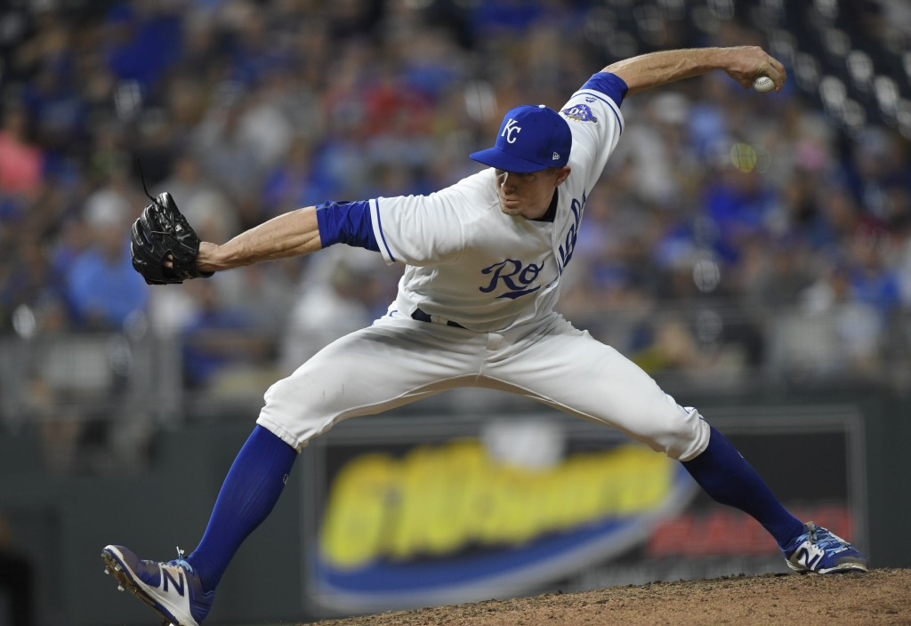 Kansas City Royals relief pitcher Tim Hill throws against the Minnesota Twins during the seventh inning of a baseball game in Kansas City, Mo., Saturd