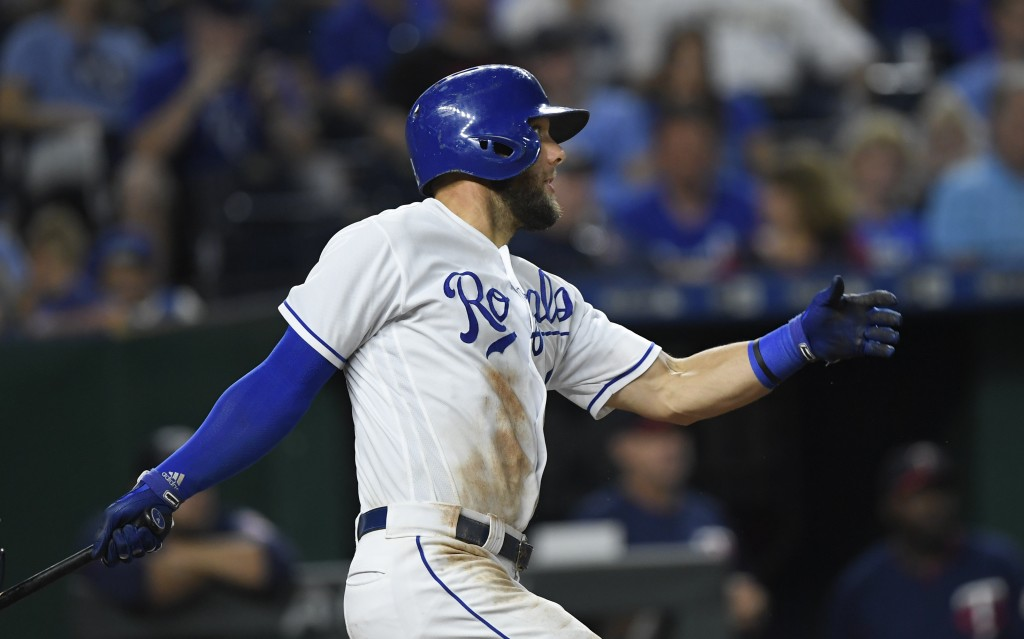 Kansas City Royals' Alex Gordon hits a two-run double against the Minnesota Twins during the sixth inning of a baseball game in Kansas City, Mo., Satu